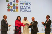 Abdulla Nasser Lootah, Director General, FCSA, UAE, presents a silver falcon to Maya Tissafi, Ambassador of Switzerland to the UAE, as the host of the next World Data Forum. Image: IISD/ENB | Kiara Worth
