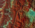 This image captured by the Copernicus Sentinel-2A satellite on 28 December 2015. It demonstrates Nepal's varied terrain from the mountains to the north (left side) to the plains in the south (right side). Vegetation appears red in this false-colour image, while waterways and buildings appear light green and blue. Image: ESA.