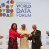 Abdulla Nasser Lootah, Director General, FCSA, UAE, presents a silver falcon to Maya Tissafi, Ambassador of Switzerland to the UAE, as the host of the next World Data Forum. Image: IISD/ENB   Kiara Worth