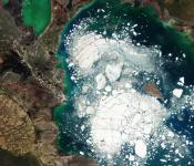 This Copernicus Sentinel-2 image shows Kazakhstan's Alakol Lake on which large chunks of broken ice float in 5 April, 2016. Climate change threatens to disappear more than one third of Central Asia's glaciers raising the disaster risk for vulnerable communities. Image: ESA.