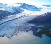 The terminus of Bear Glacier occurs in iceberg filled freshwater lagoon. Kenai Fjords National Park, Alaska. Image: NASA.