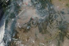 Satellite image of active wildfires across Western U.S., outlined in red (Image: NASA)