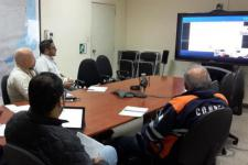 EOC members in a video conference with CONAE
