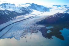 The terminus of Bear Glacier occurs in iceberg filled freshwater lagoon. Kenai Fjords National Park, Alaska. Image: NASA.