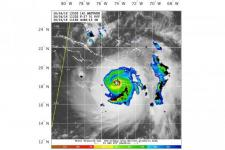 Satellite image from the Naval Research Lab are overlaid with lightning strokes (shown as black circles) of Hurricane Mathew on 4 October 2016. Image: WWLLN-TC